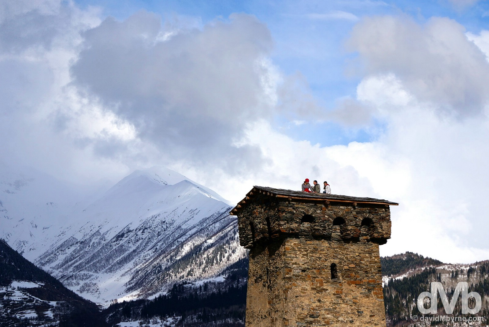 Sitting atop one of the distinctive Svan Towers in the highland town of Mestia in the Caucasus Mountains in northwest Georgia. March 21, 2015.