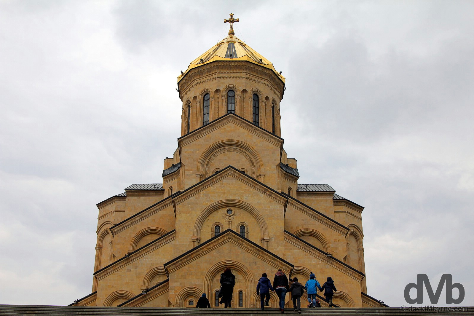 Climbing the steps fronting the massive Tsminda Sameba Cathedral in Tbilisi, Georgia. March 19, 2015.