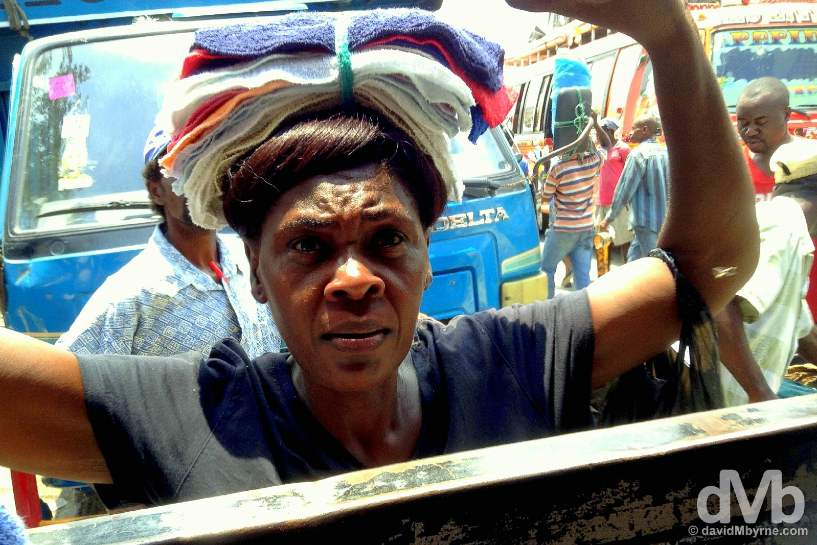A vendor peddling her wares to bus passengers in Port-au-Prince, Haiti. May 19, 2015.