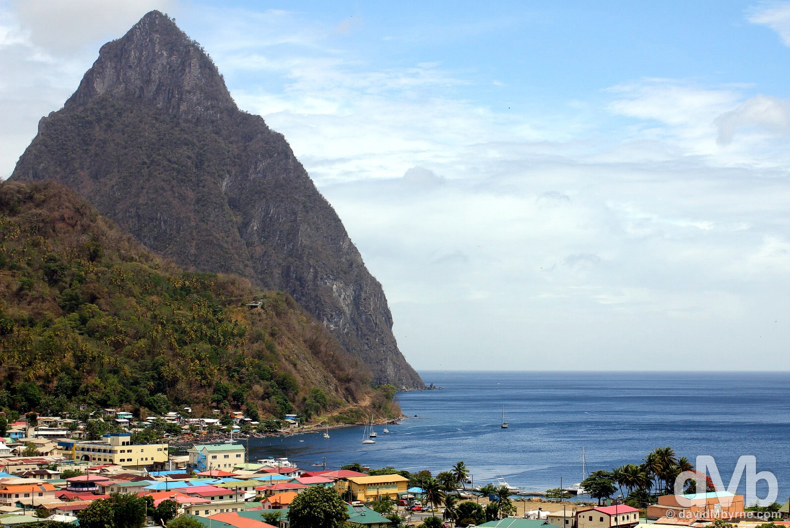 Petit Piton & the town of Soufriere in southeastern St. Lucia, Lesser Antilles. June 15, 2015.