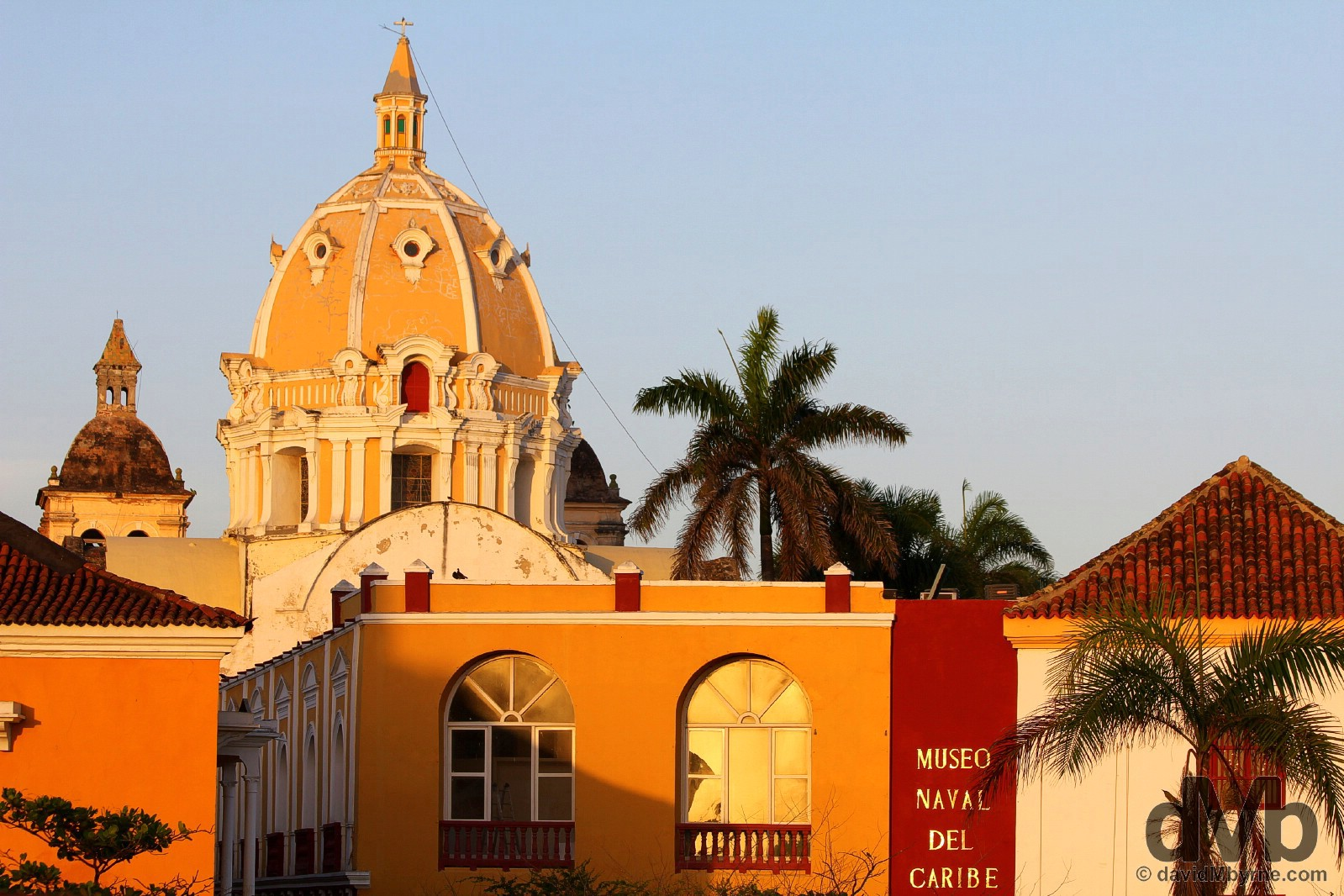 Sunset light on buildings of Old Town as seen from Las Murallas, the Old Town walls of Cartagena, Colombia. June 24, 2015.