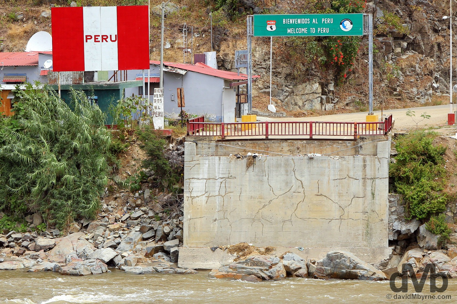Peru as seen across the Macara River outside the town of Macara, southern Ecuador. July 28, 2015.