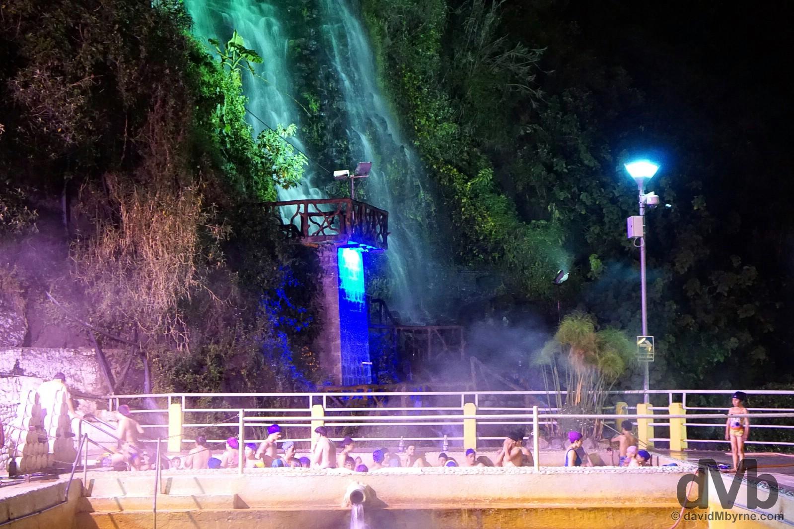 Night bathing at the Piscinas de la Virgen near the base of the Virgen waterfall in Banos, Ecuador. July 9, 2015.