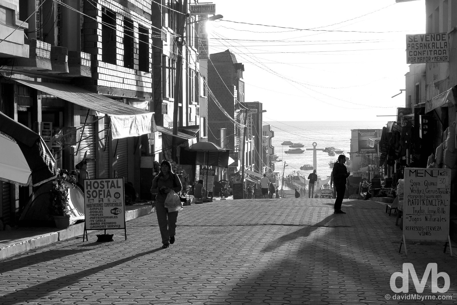 Late afternoon shadows on Avenue 6 de Agosto, tourist central in Copacabana, Bolivia. August 24, 2015.