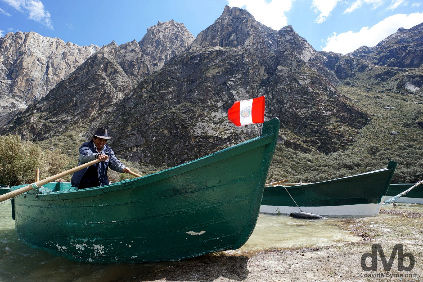 A boatman on Lago (Lake) Chinan Cocha in Parque Nacional Huascaran, Ancash, Peru. August 5, 2015.
