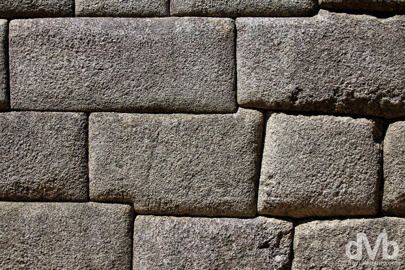 An example of rectangular convex Inca style brickwork of the site's main temple, the Temple of the Sun, a semi-circular, stunted tower-like structure that displays some of Machu Picchu's finest granite stonework. Machu Picchu, Peru. August 15, 2015.