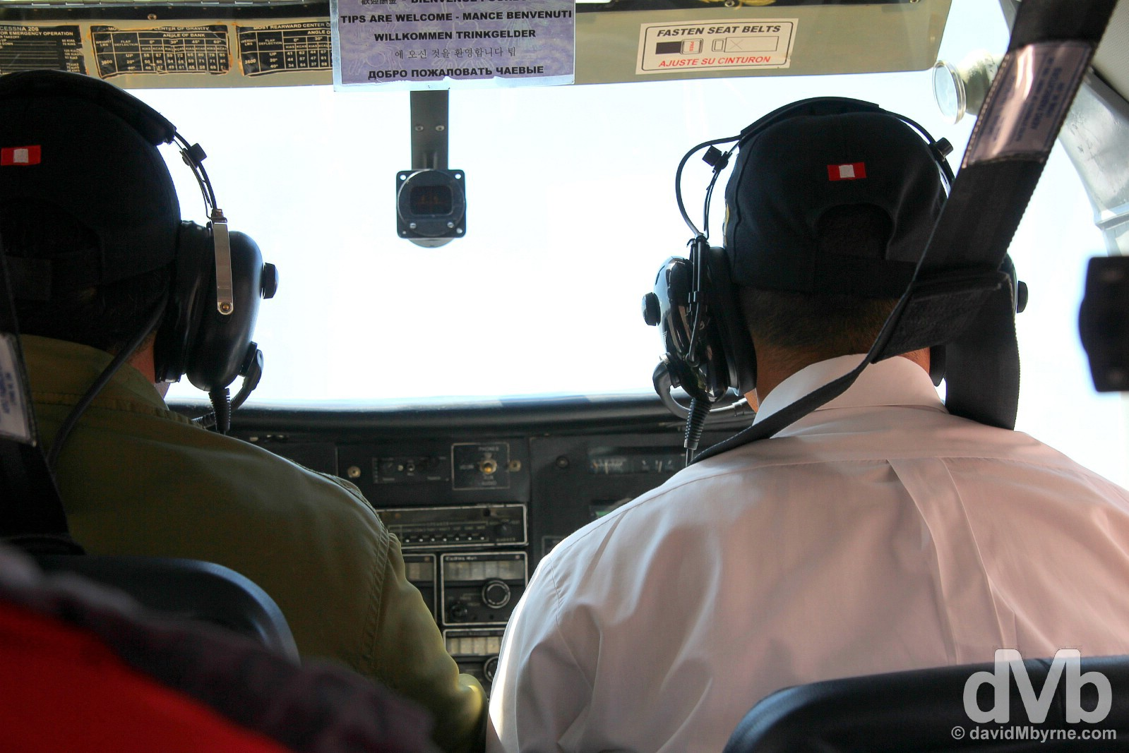 Pilot & copilot in the compact cockpit of a Cessna C206 over the Nasca Plain in southern Peru. August 11, 2015.