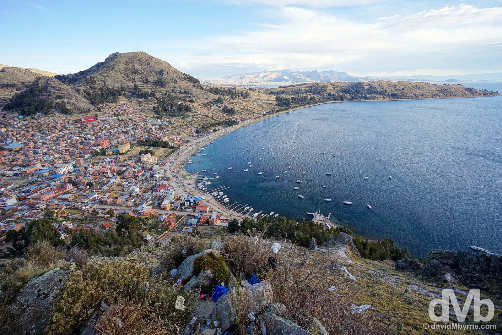 The town of Copacabana on the shores of Lake Titicaca as seen from the pilgrimage mountain Cerro Calvario. Copacabana, Bolivia. August 23, 2015.