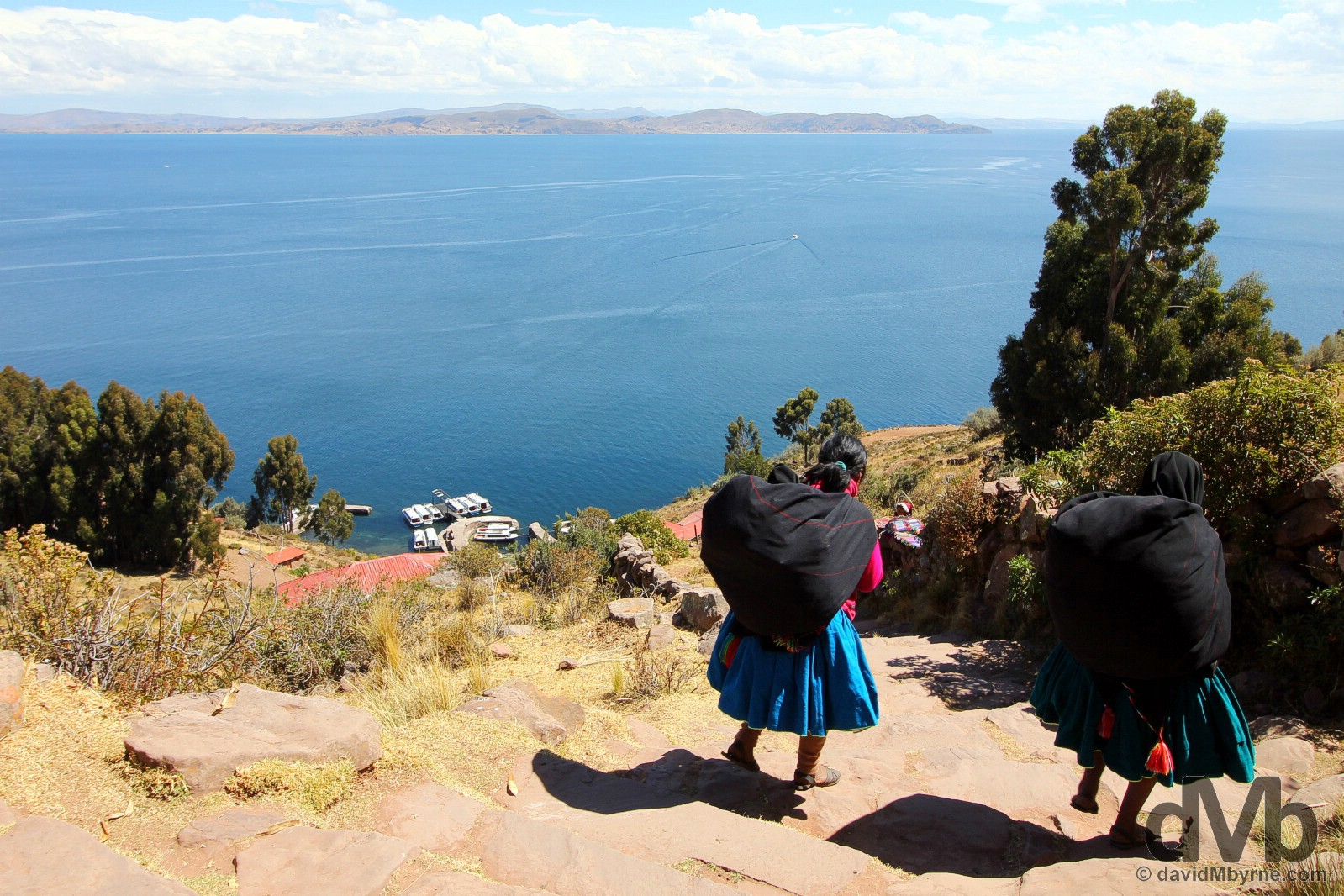 Locals descending to the port on Taquile Island, Lake Titicaca, Peru. August 21, 2015.