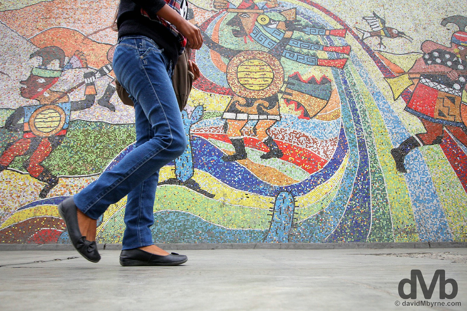 Walking past the mosaic on the walls of the Universidad Nacional de Trujillo in Trujillo, northwestern Peru. August 1, 2015.