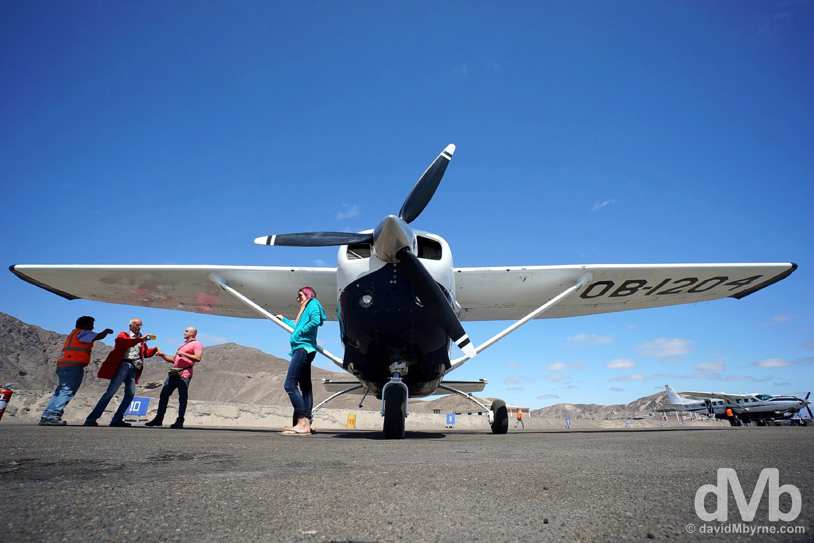 Cessna C206 on the tarmac of Nasca Airport prior to departure for a flight over the Nasca Plain to view the Nasca Lines. Nasca, southern Peru. August 11, 2015.