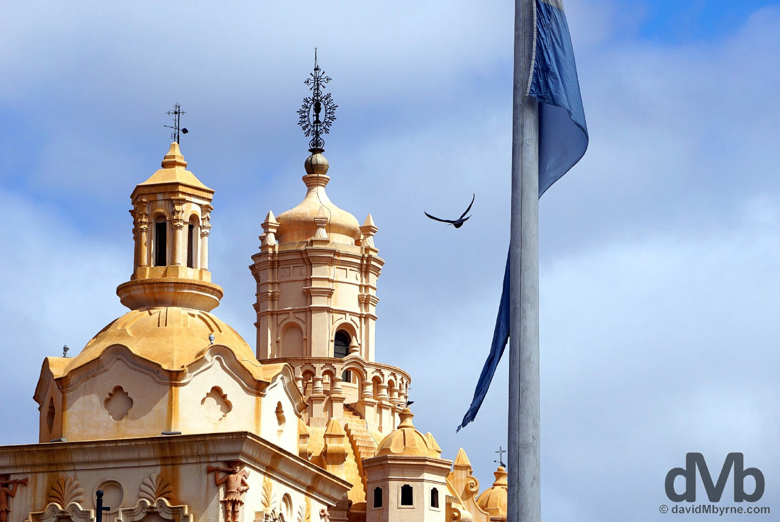 The cathedral & a flag pole as seen from Plaza San Martin in Cordoba, Argentina. September 24, 2015.
