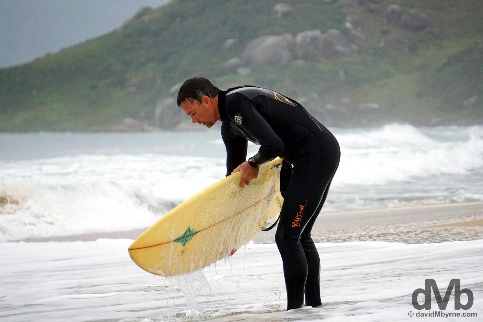 A surfer on Praia Mole on Ilah Santa Catarina, Brazil. September 17, 2015.