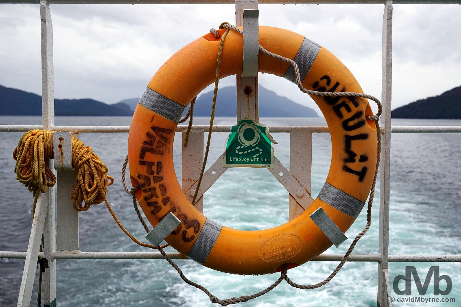 A life ring of the Valparaiso registered Queulat (slowly) plying the Canal Moraleda en route from Quellon, Chiloe, to Puerto Chacabuco, Chile. October 25, 2015.