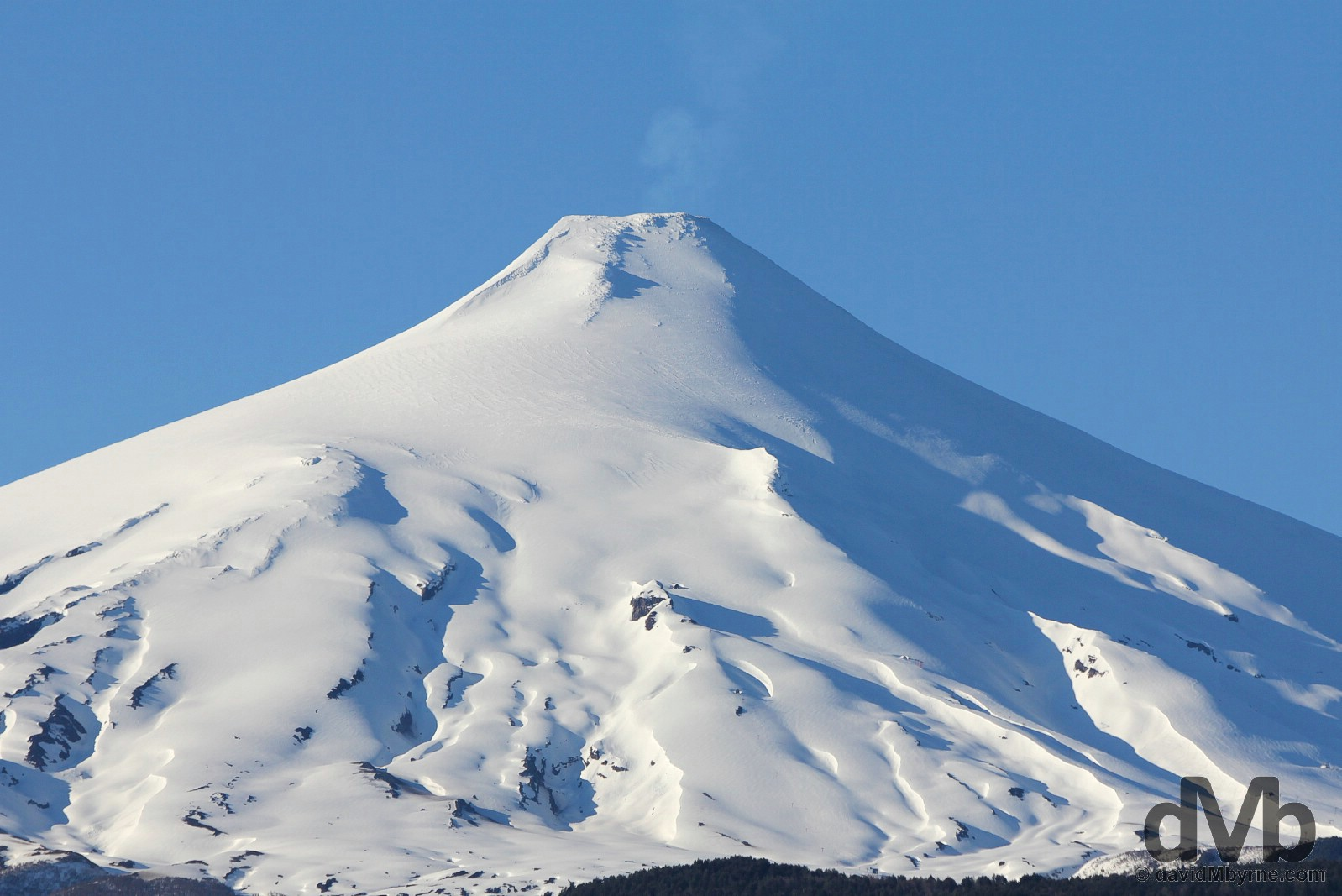 Steaming Volcan Villarrica as seen from Pucon, Lake District, Chile. October 11, 2015.