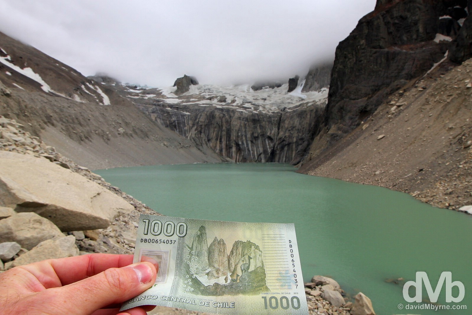 The missing pieces. The Torres del Paine peaks, shrouded by cloud on this day, as seen on the rear of the Chilean 1000 peso note on the edge of Laguna Torre in Parque Nacional Torres Del Paine, southern Patagonia, Chile. November 7, 2015.