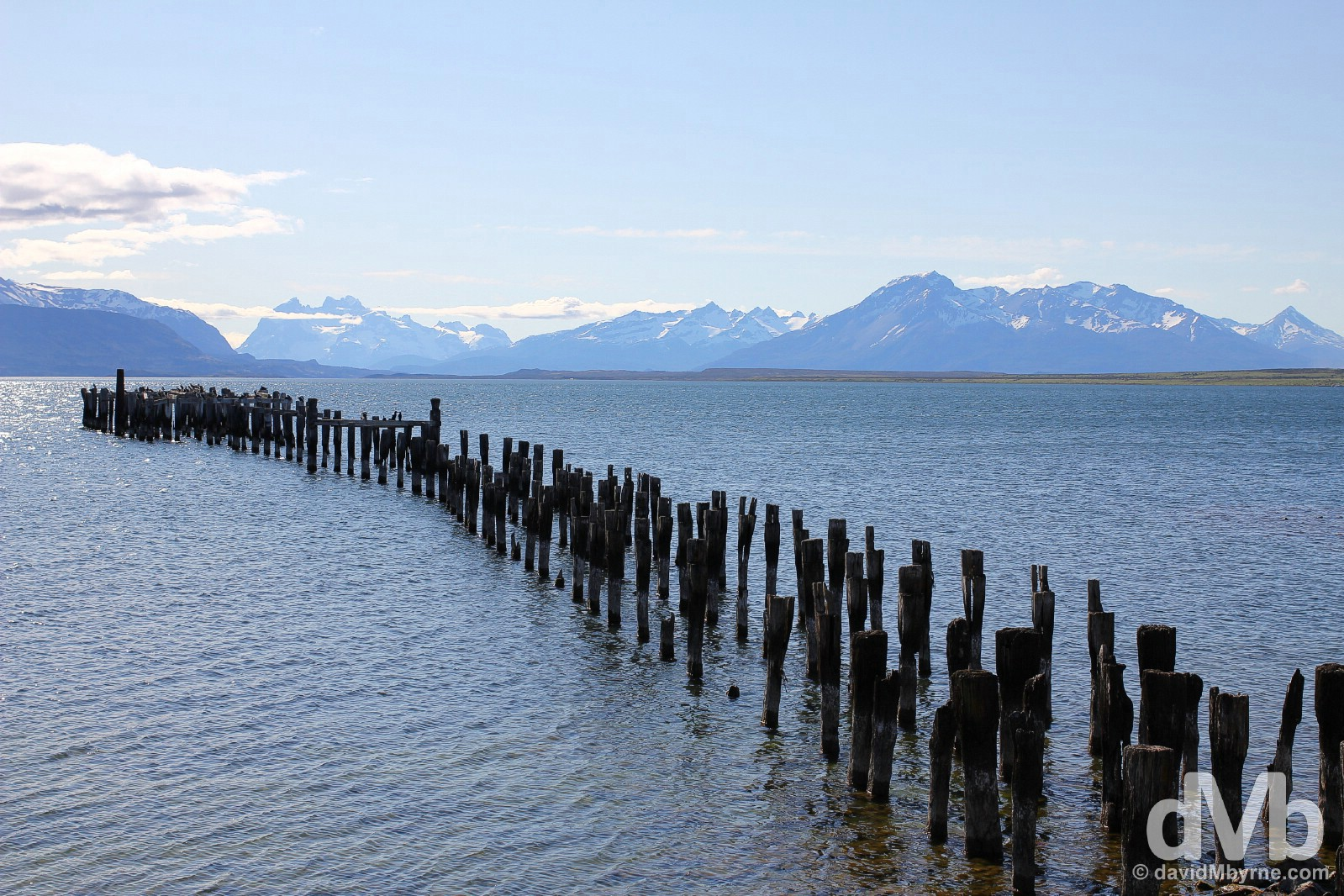 The remains of the Braun & Blanchard wharf in Seno Ultima Esperanza (Last Hope Sound) with the peaks of Torres Del Paine in the distance. Puerto Natales, southern Patagonian Chile. November 6, 2015.