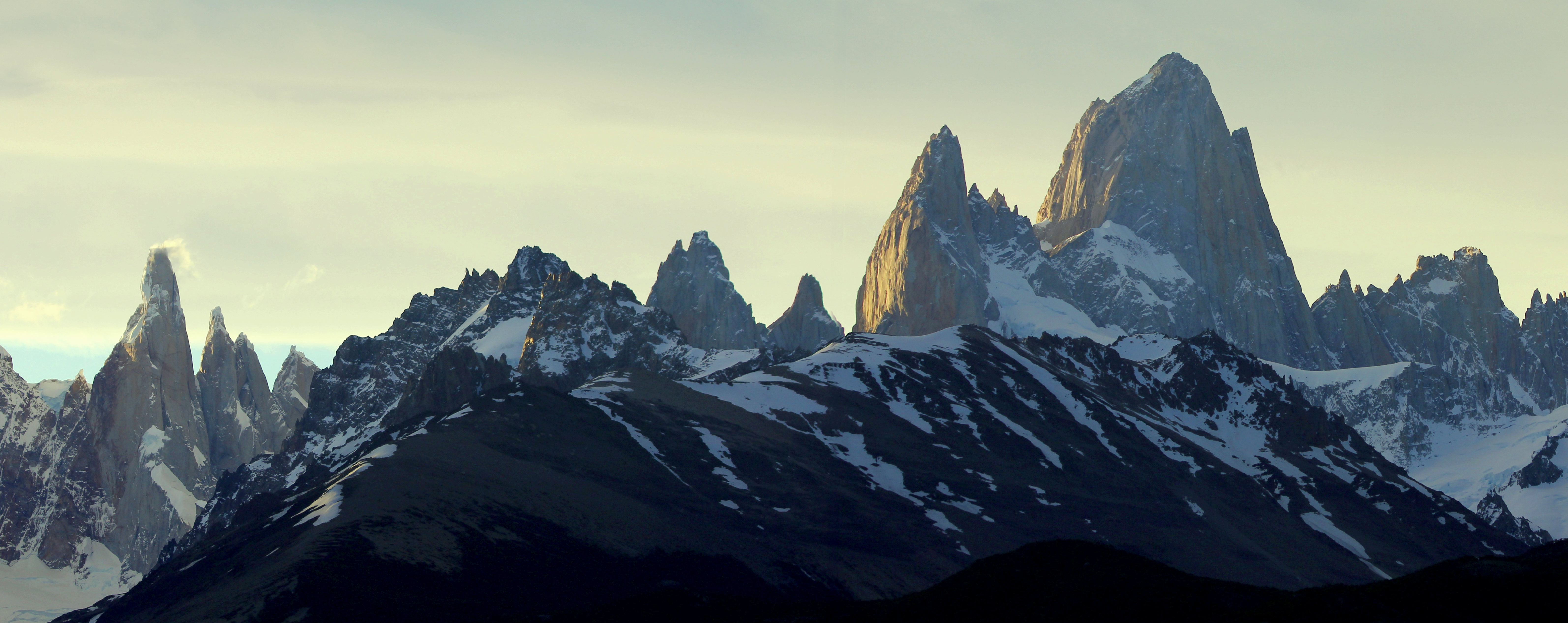 A panorama showing the last rays of the day striking the distinctive peaks of the Fitz Roy sector of Parque Nacional Los Glaciares in southern Patagonia, Argentina. November 3, 2015.