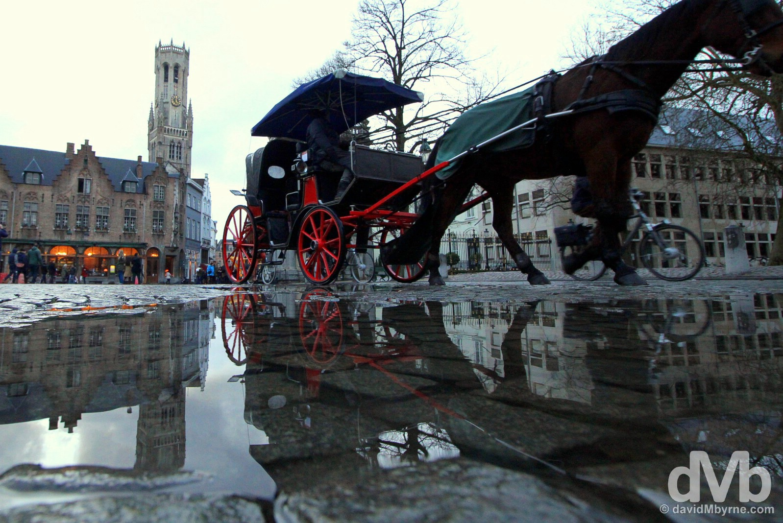 A horse-drawn carriage in Burg, Bruges, western Flanders. Belgium. January 16, 2016.
