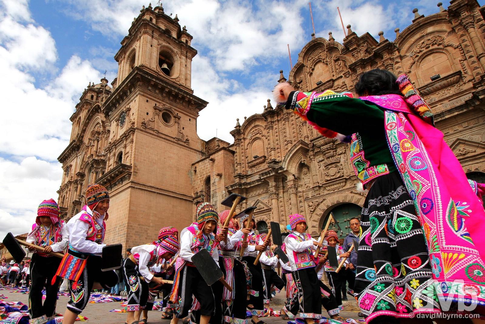 Festival activity outside the twin-towered La Compania de Jesus on Plaza de Armas, Cusco, Peru. August 16, 2015.