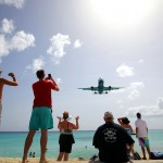 An arrival party on Maho Beach welcoming the latest arrival into Juliana Airport on Sint Maarten, Lesser Antilles. June 8, 2015.