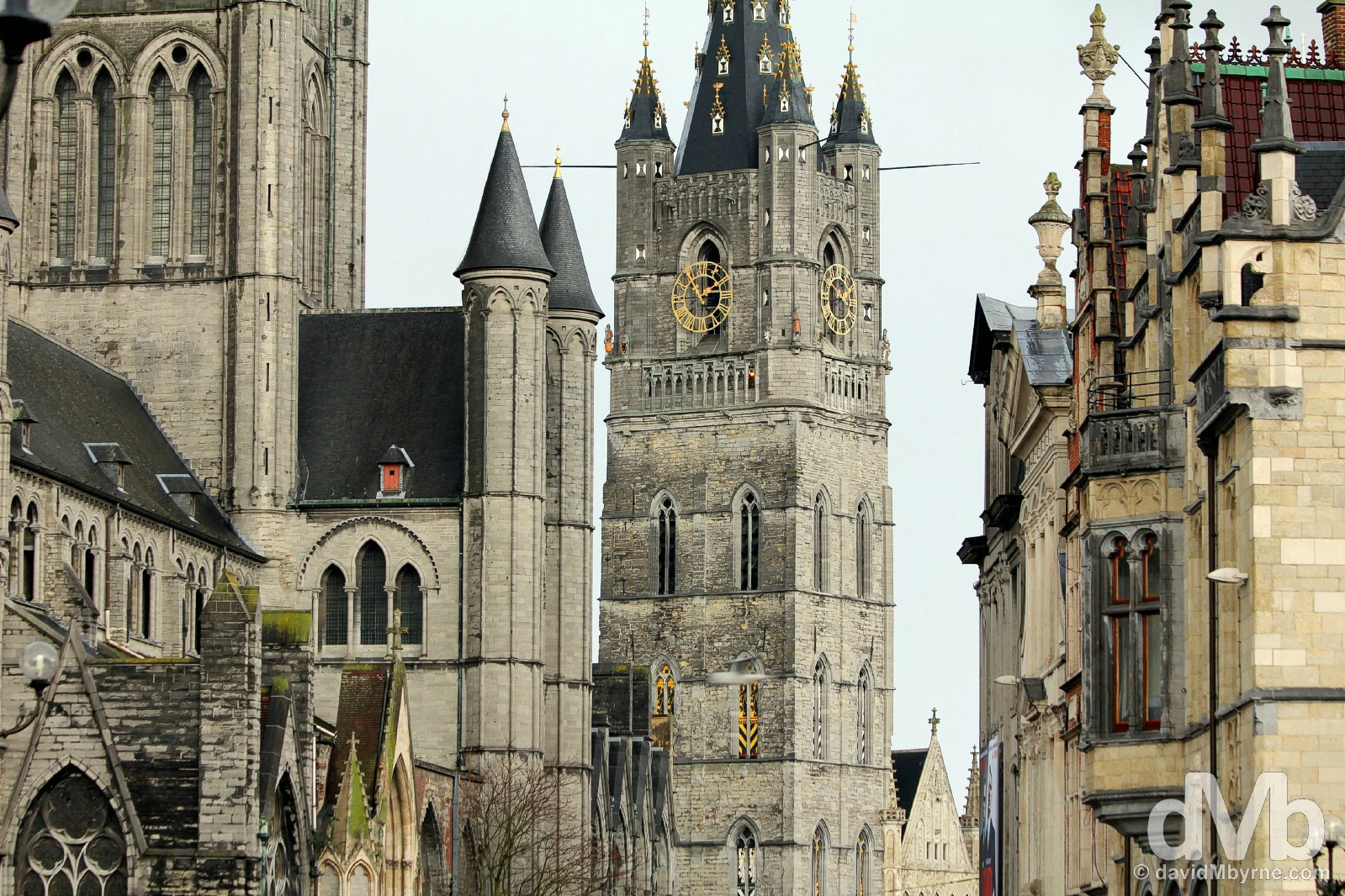 Sint Niklaaskerk/St. Nicholas' Church, left, & the UNESCO-listed Belfry in Ghent, centre, as seen from the St Michielsburh bridge over the Leie River in Ghent, western Flanders, Belgium. January 15, 2016.