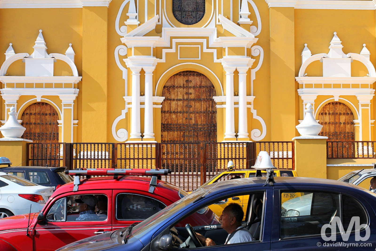 Traffic outside La Catedral on Plaza Mayor, Trujillo, northern Peru. July 31, 2015.