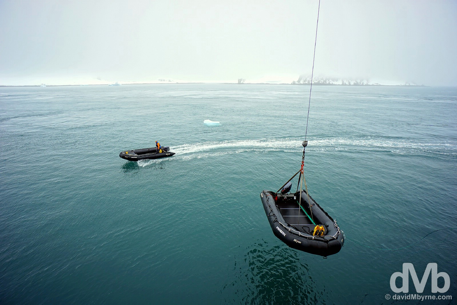 Zodiacs being lowered from the M/V Ocean Endeavour into the water after arrival at the sub-Antarctic Aticho Island group of the South Shetland Islands. November 28, 2015.