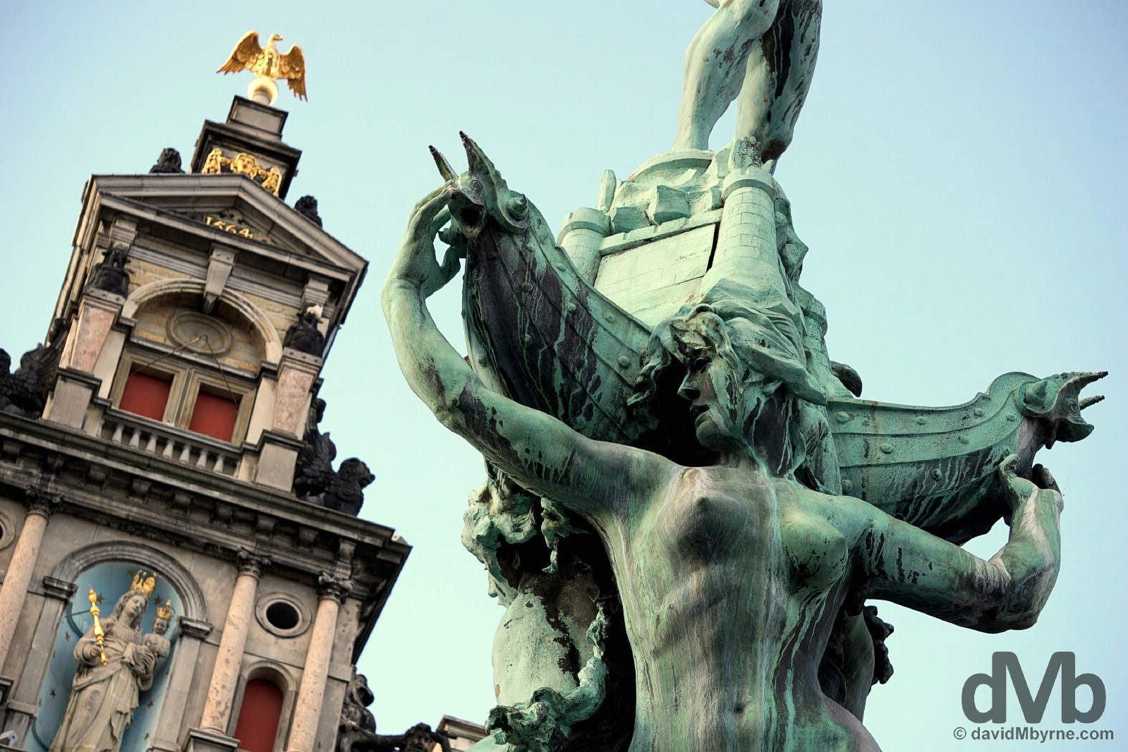 Brabo Fountain statue and the central tower of the Stadhuis in Grote Markt, Antwerp, Belgium. January 17, 2016.