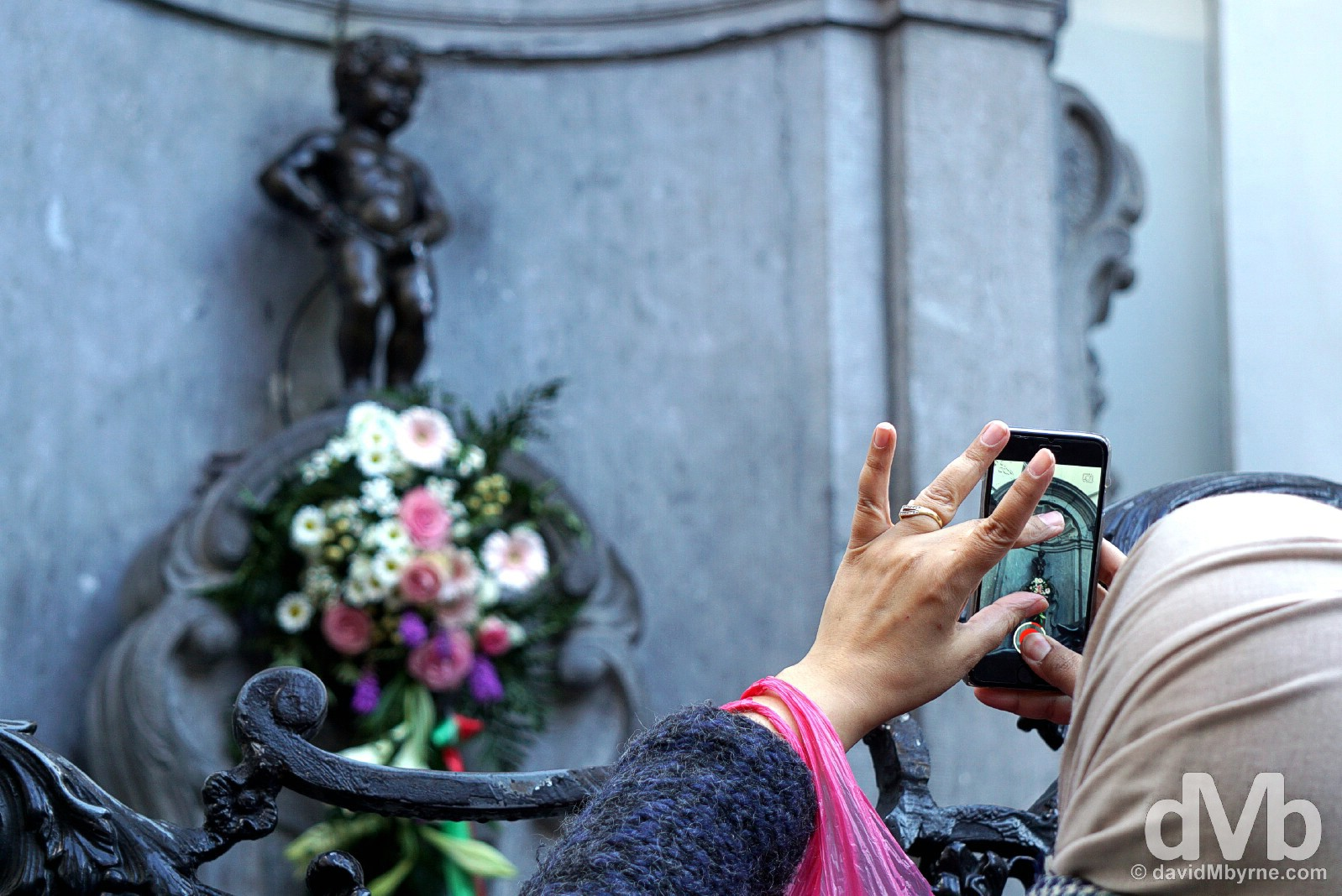 Capturing the tiny Manneken Pis statue, a national symbol of Belgium. Brussels, Belgium. January 14, 2016