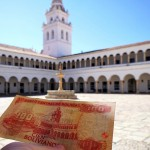 A 100 bolivianos note/bill (€13) in the central courtyard of Universidad in Sucre, Bolivia. August 31, 2015.