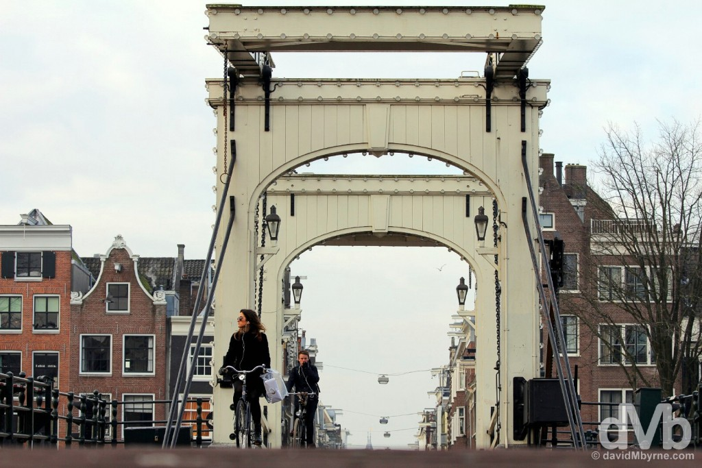 Crossing Magere Brug in Amsterdam, Netherlands. January 19, 2016.