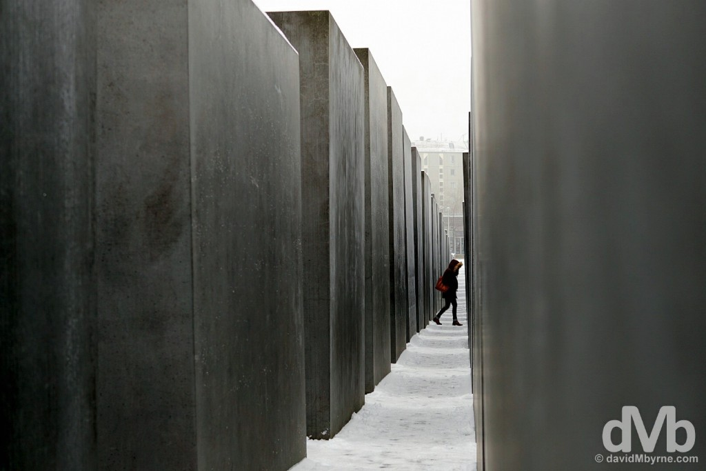 Walking through the two thousand, seven hundred and eleven gray concrete slabs, or stelae, of the Memorial to the Murdered Jews of Europe, a.k.a the Holocaust Memorial, in Berlin, Germany. January 23, 2016.