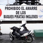A sign reading 'The Mooring of English Pirates Ships Prohibited'' outside the entrance to the port in Ushuaia, Tierra del Fuego, Argentina. November 13, 2015.