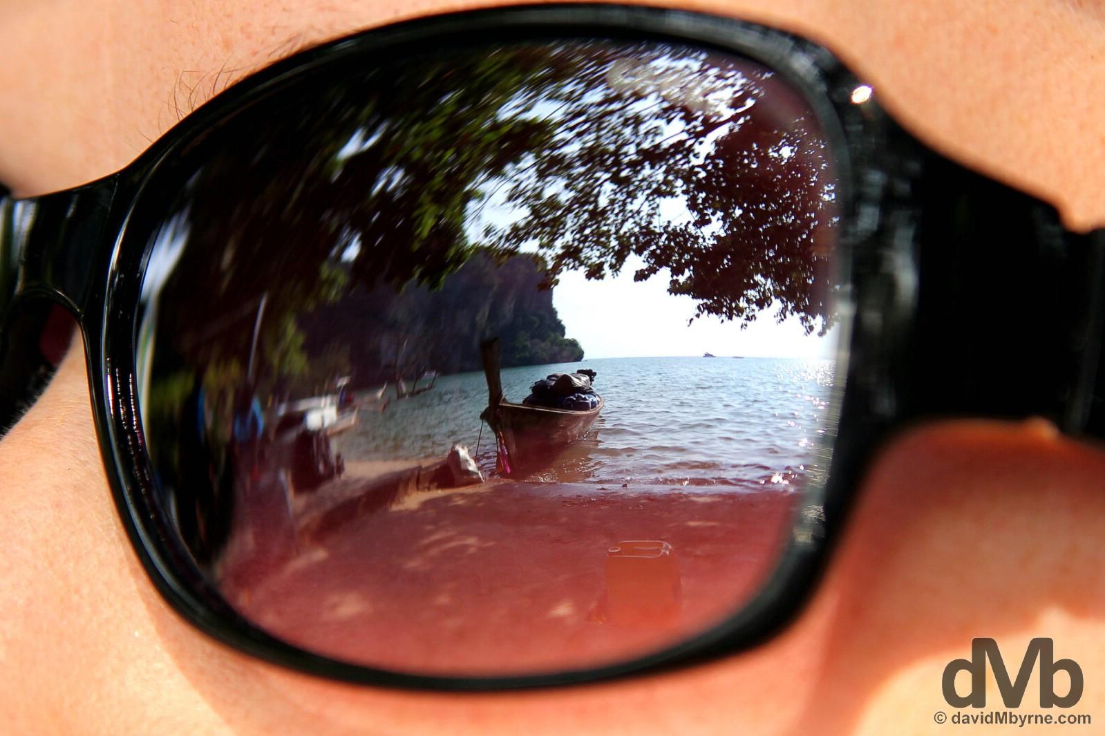 Long-tail boat reflections on Hat Rai Leh West Beach, Krabi, Thailand, Thailand. March 20, 2012.