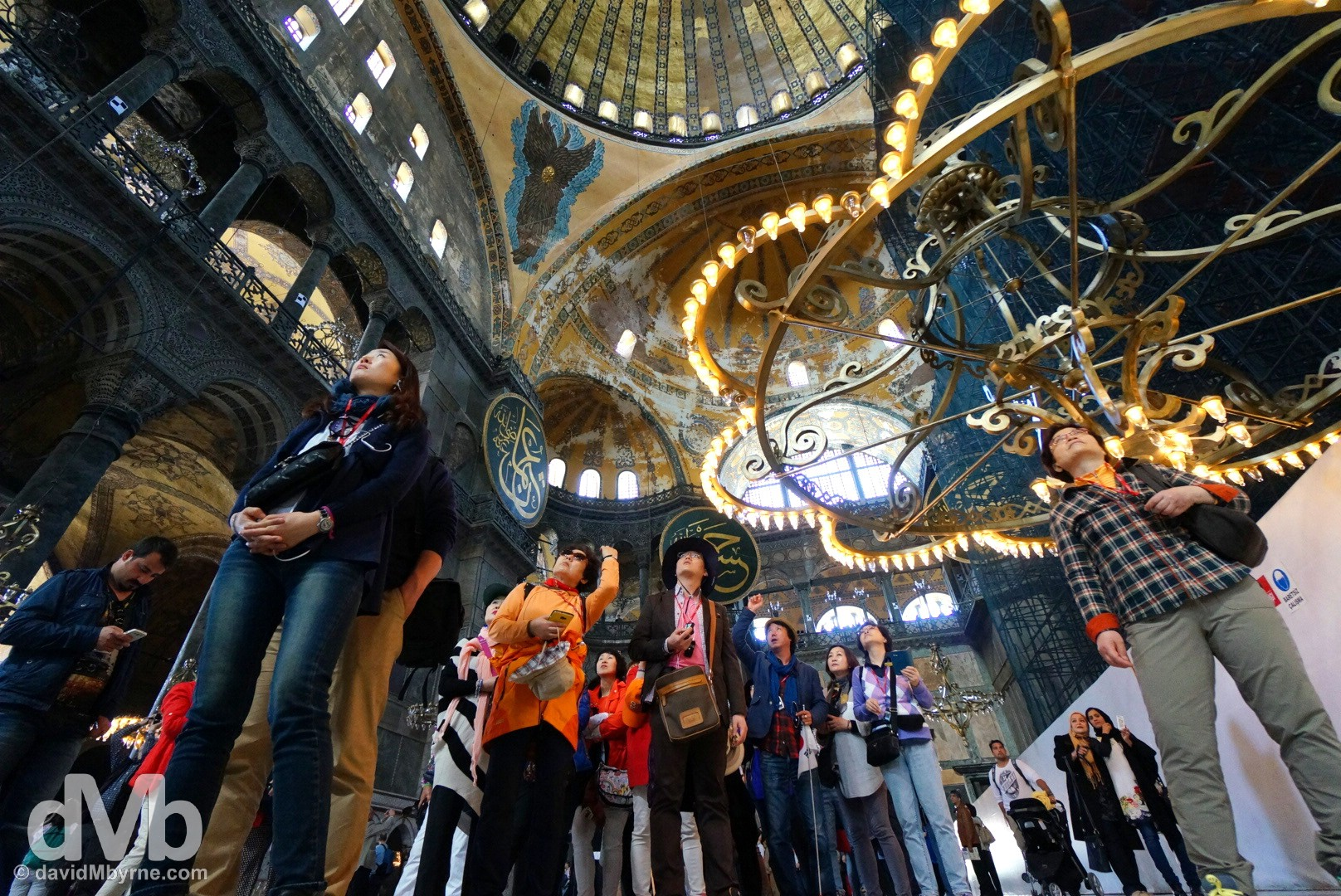 A group of flag-following Korean tourists admiring the interior of the Hagia Sophia in Istanbul, Turkey. April 10, 2014.