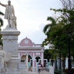 The Jose Marti statue & the Arco de Triunfo, Cuba's only triumphal arch in Parque Jose Marti, Cienfuegos, Cuba. May 7, 2015.