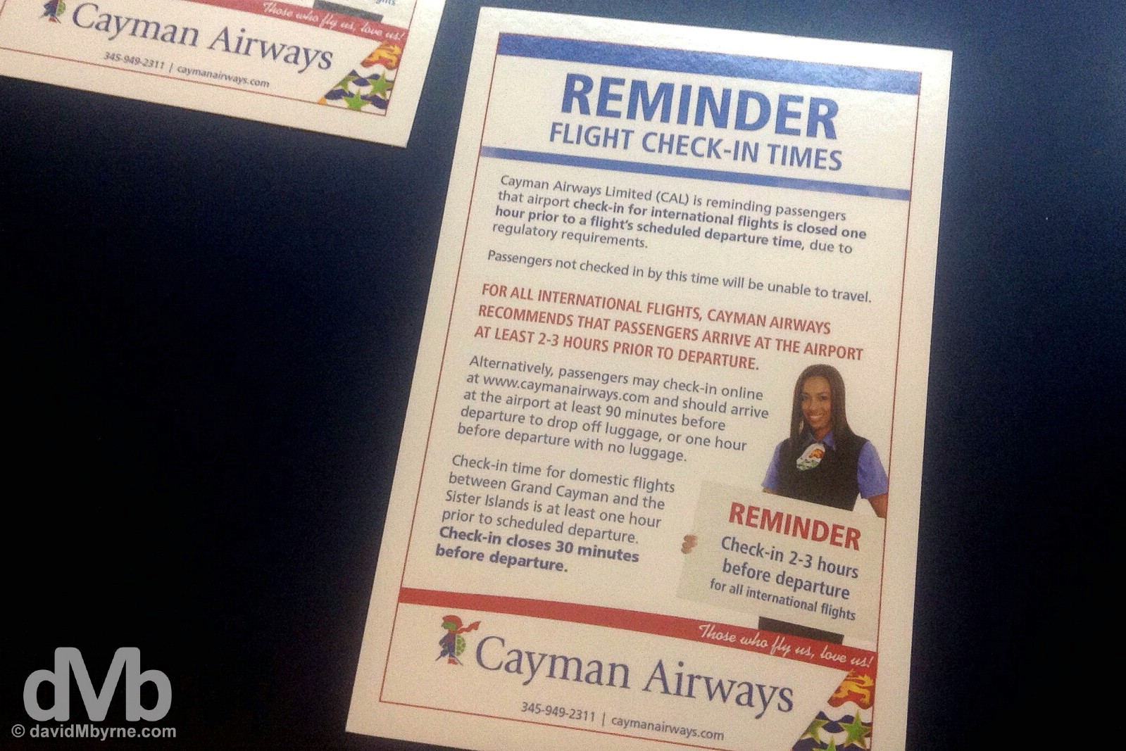 Cayman Airways Check-in reminder. Owen Roberts International Airport, Grand Cayman, Cayman Islands, Greater Antilles. May 12, 2015.