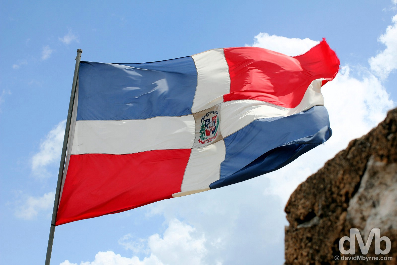 The Dominican Republic flag flying over the Torre del Homenage in Fortaleza Ozama, Santo Domingo, Dominican Republic, Hispaniola, Greater Antilles. May 26, 2015.
