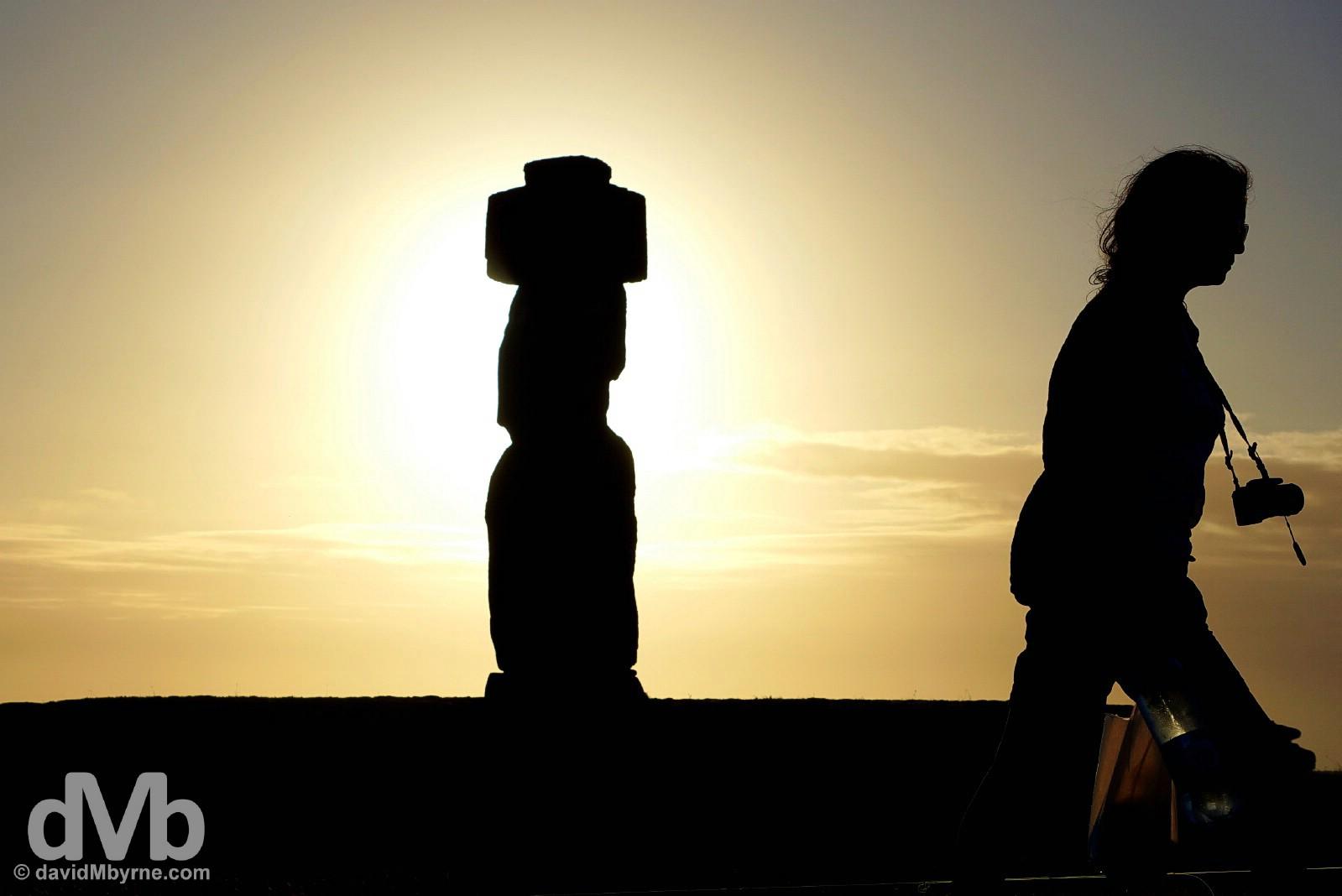 Sunset silhouettes at Ahu Ko Te Riku, Tahai, Easter Island, Chile. September 28, 2015.