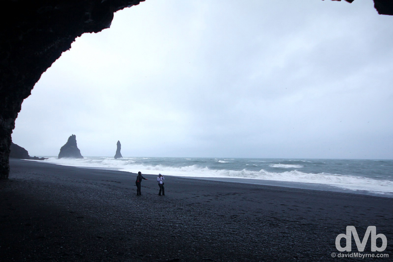 Braving the elements on the black sand beach at the base of the hill Reynisfjall in Myrdalur, southern Iceland. December 5, 2012.