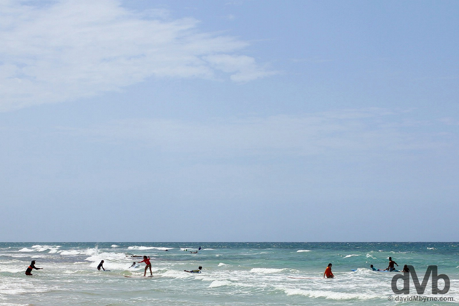 Surfing lessons on Playa Ocean Park in San Juan, Puerto Rico, Greater Antilles. June 1, 2015.