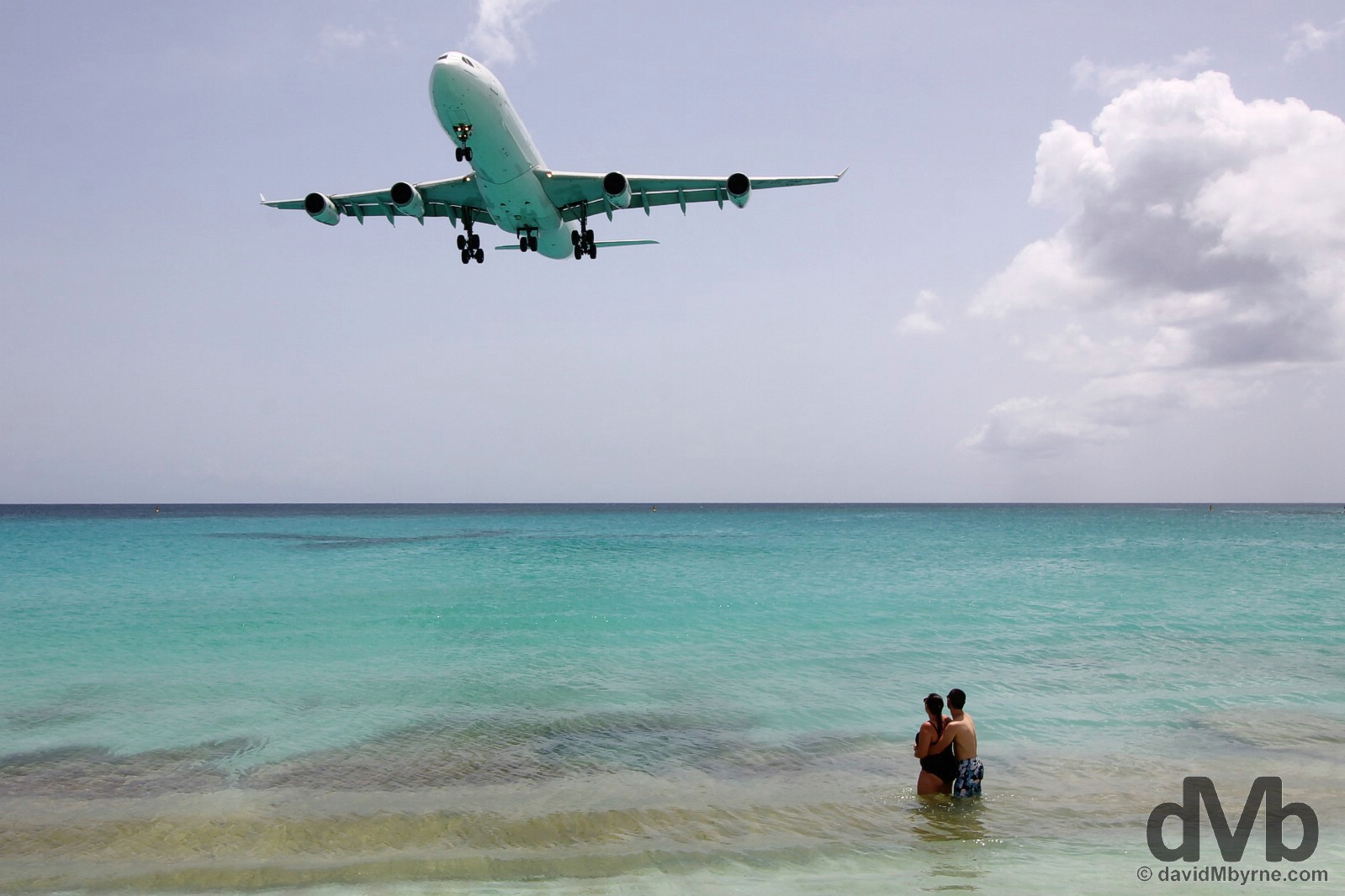 An approach to Juliana Airport as viewed from the warm waters of Maho Bay, Sint Maarten, Lesser Antilles. June 8, 2015.