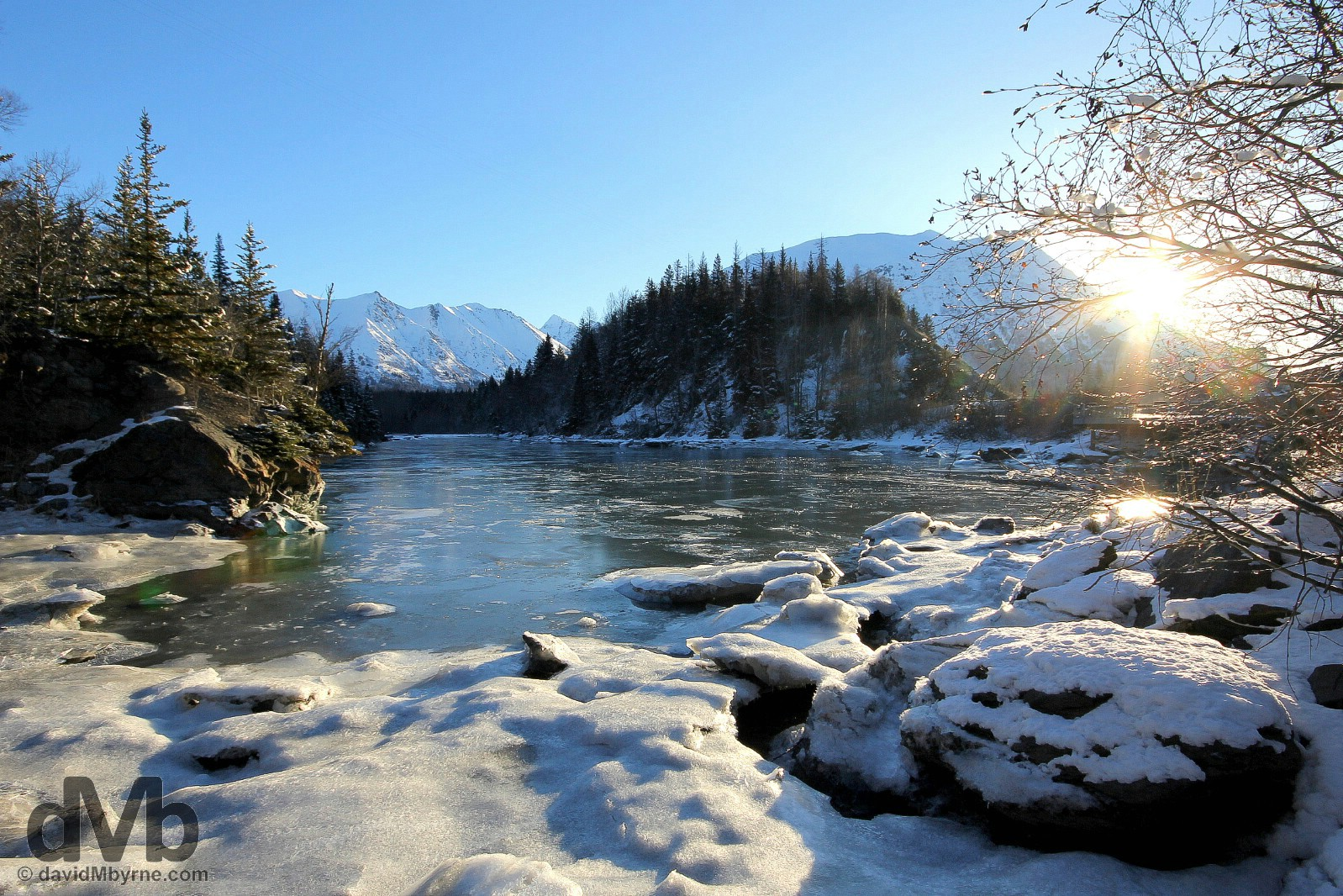 The first rays of the day in Bird Creek off the Seward Highway, Alaska, USA. March 12, 2013.