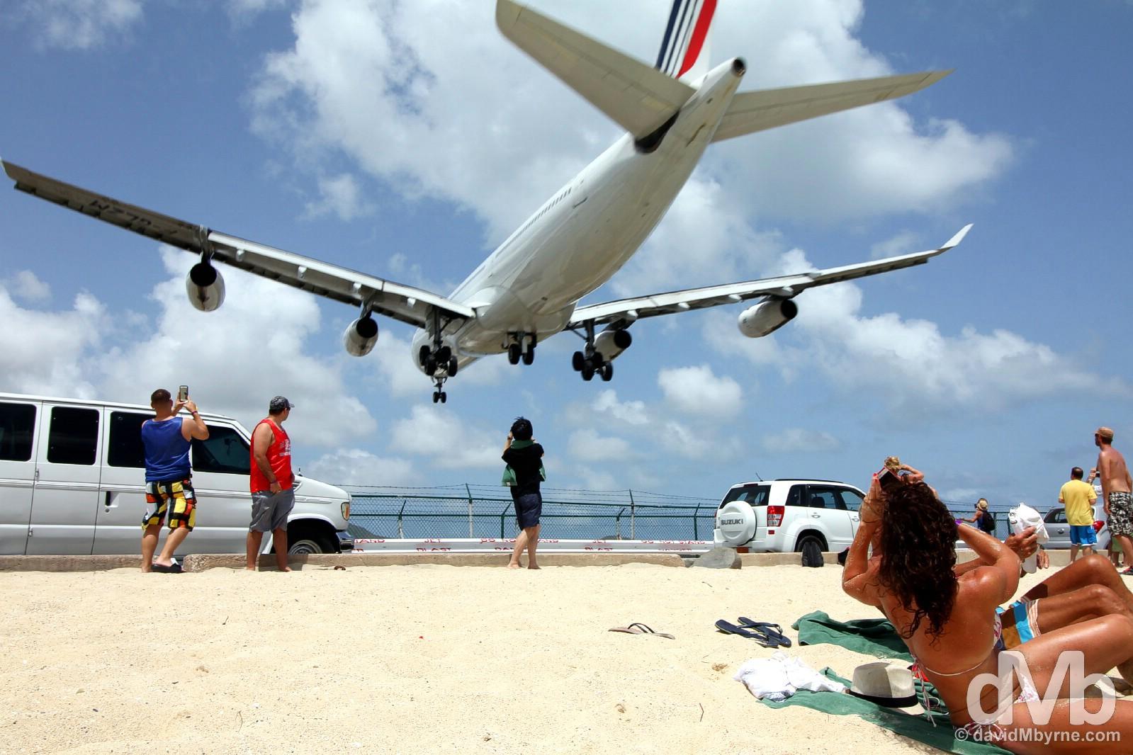 Disturbing sunbathing. An approach to Juliana Airport over the sands of Maho Beach, Sint Maarten, Lesser Antilles. June 8, 2015.