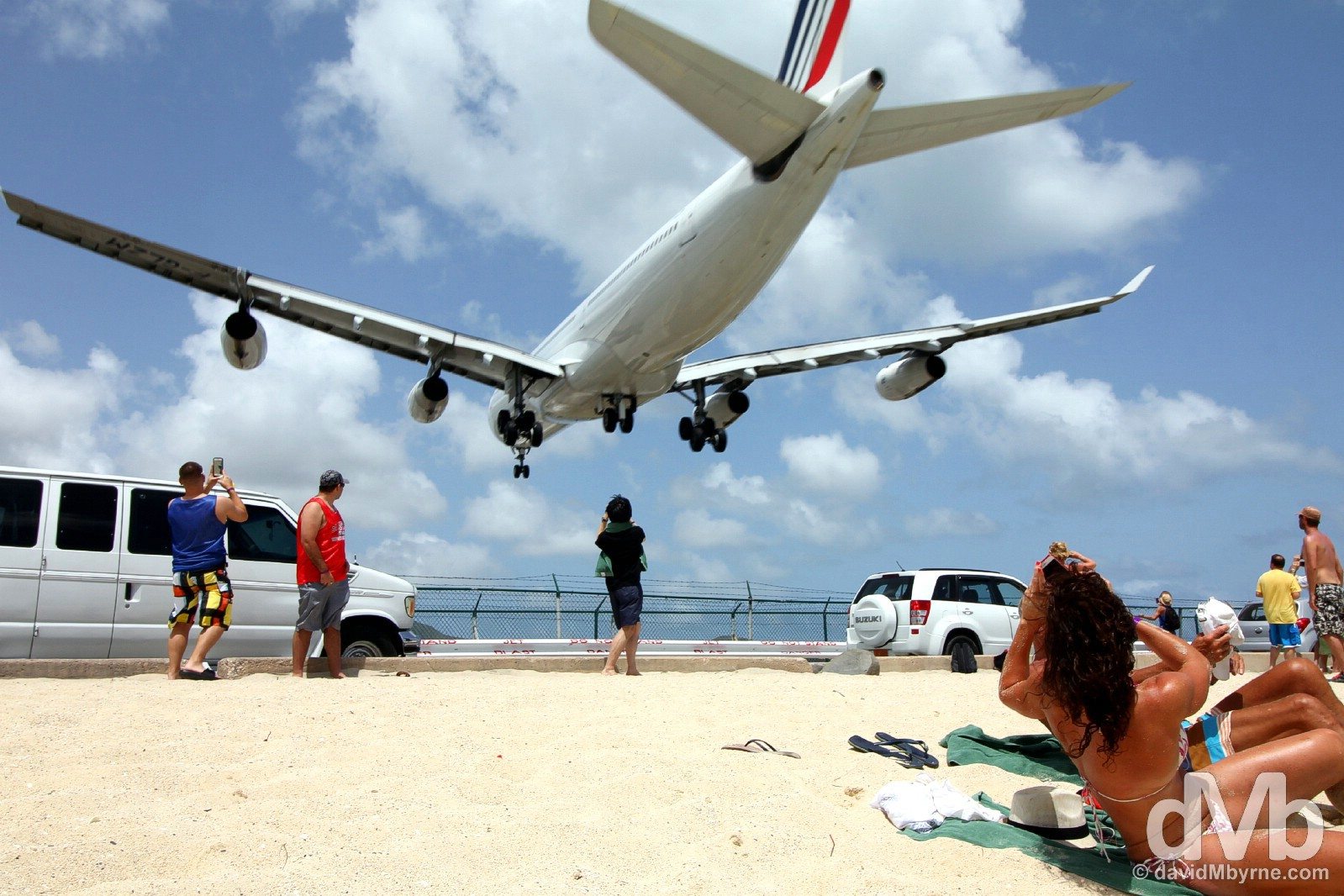 Disturbing sunbathing. An approach to Juliana Airport over the sands of Maho Beach, Sint Maarten, Lesser Antilles. June 8, 2015.