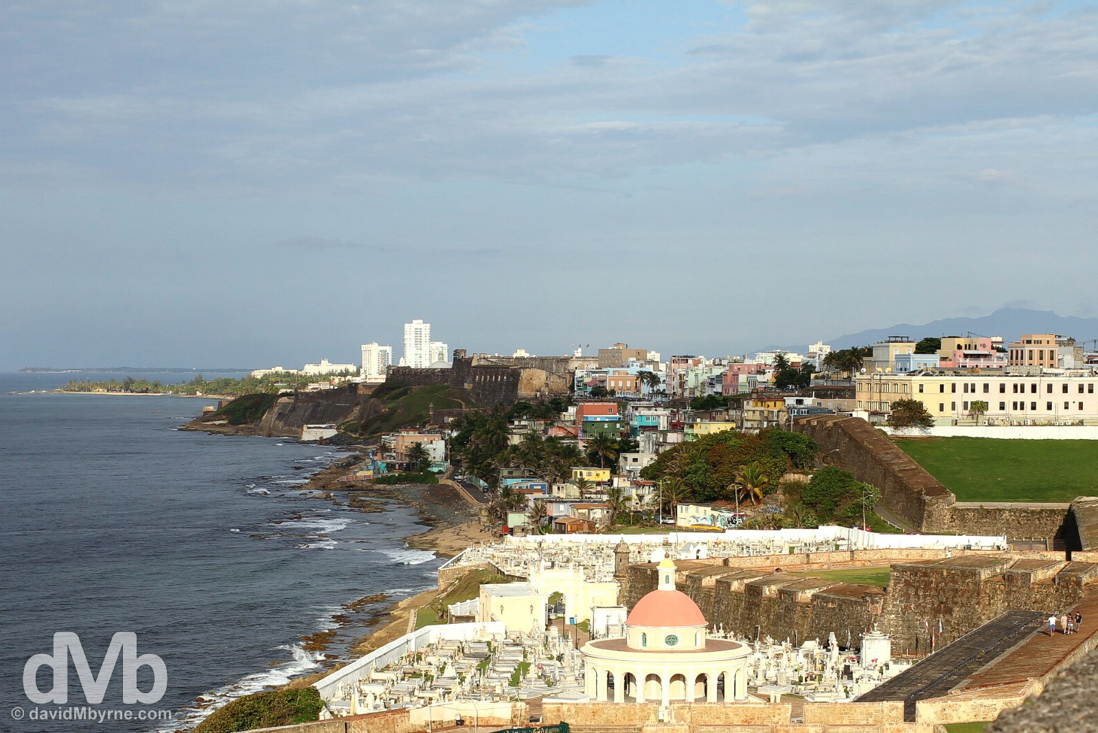 The northern, Atlantic-facing coast of the San Juan Islet as seen from the ramparts of Castillo San Felipe del Morro in Viejo (Old) San Juan, Puerto Rico, Greater Antilles. June 2, 2015.