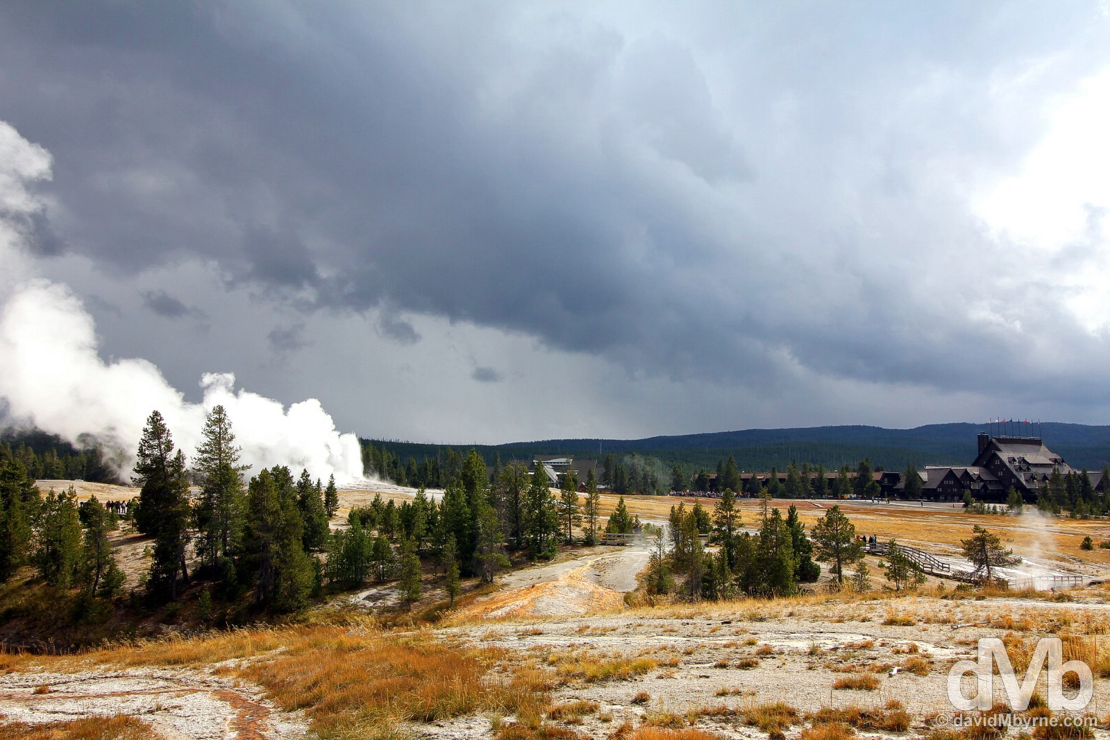 Old Faithful and the Old Faithful Inn as seen from Geyser Hill of Upper Geyser Basin, Geyser Country, Yellowstone National Park, Wyoming, USA. September 5, 2016.
