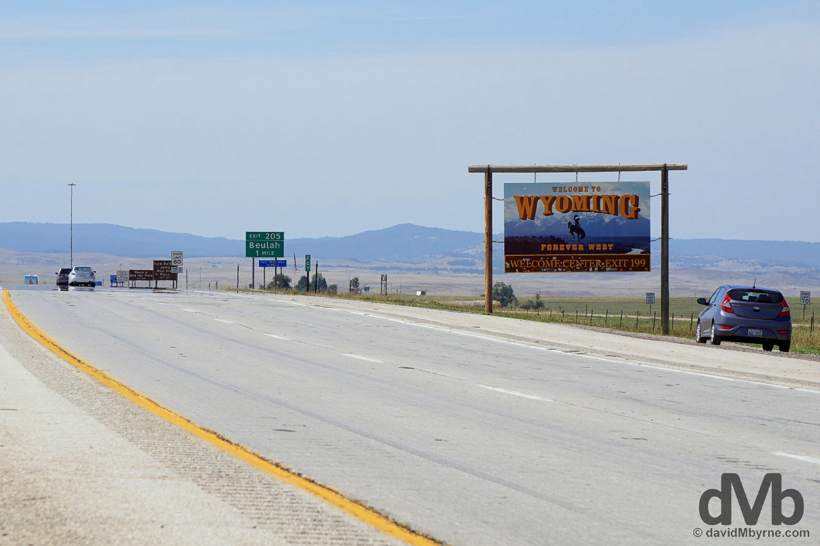 At the 'Welcome to Wyoming' sign on the South Dakota-Wyoming state line, Interstate 90, USA. September 3, 2016.