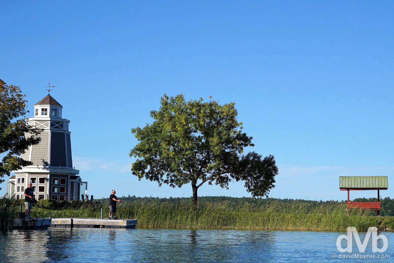 Fishing in Walker City Park on the edge of Leech Lake. Walker, northern Minnesota, USA. August 30, 2016.